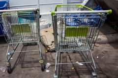 Supermarket trolley. In the parking Stock Images