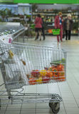 In supermarket trolley with pepper and other products. In indoors supermarket trolley with pepper and other products Stock Images