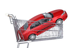 Supermarket trolley with red car inside it. Supermarket trolley with red sedan car inside it. Side view, on white background Royalty Free Stock Photos