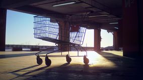 Supermarket trolley rides on the parking lot stock video