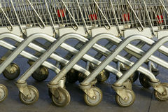 Supermarket trolleys. Row of metal trolleys in a supermarket Royalty Free Stock Photography
