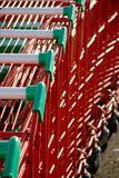 Supermarket trolleys. Green and red supermarket trolleys Stock Photos