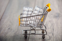 Supermarket trolleys filled with pills Stock Photos