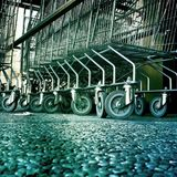 Supermarket trollies. Row of metal supermarket trollies from low angle of view Stock Photos