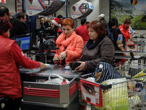 Supermarket week end shopping. Bucharest, Romania, December 24, 2015: Customers paying for shopping at a supermarket in Bucharest Stock Photo