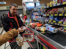 Supermarket week end shopping. Bucharest, Romania, December 24, 2015: Customers paying for shopping at a supermarket. Line at the cashdesks in the supermarket Stock Photo