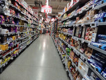 Supermarket week end shopping. Bucharest, Romania, December 24, 2015: Supermarket food shopping products aisle / isle empty Royalty Free Stock Photos