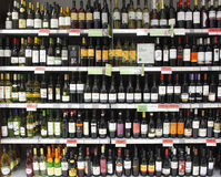 Wine bottles on shelf / shelves Royalty Free Stock Photo
