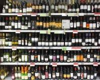 Wine bottles on shelf / shelves. Supermarket wine bottles on the shelf / shelves Royalty Free Stock Photo