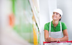 Supermarket worker with cart Stock Photos