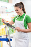Supermarket worker with clipboard Royalty Free Stock Photography