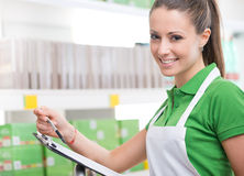 Supermarket worker with clipboard Royalty Free Stock Photo