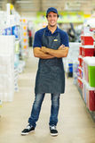 Supermarket worker. Handsome supermarket worker with arms crossed Royalty Free Stock Images