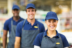 Supermarket worker team. Pretty female supermarket worker and team Stock Images