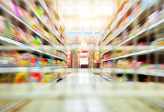 Supermarkets. Empty supermarket aisle, Motion Blur Royalty Free Stock Image