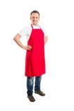 Supermarktwerknemer of slager met rode schort stock foto