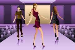 Supermodels walking on a runway show Royalty Free Stock Images