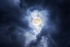 Supermoon in clouds Royalty Free Stock Image