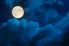 Supermoon in dramatic clouds Stock Photography