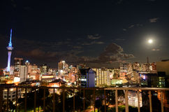 Supermoon lunar eclipse rise over Auckland skyline New Zealand Royalty Free Stock Image