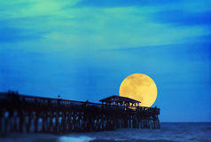 Supermoon at Myrtle Beach State Park Pier. In Myrtle Beach South Carolina USA. This is computer generated art from a photograph Stock Image