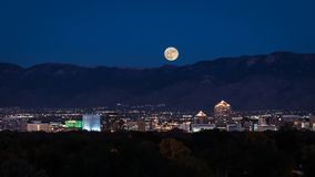 Supermoon over Albuquerque. The November 2016 `supermoon` rising over Albuquerque`s downtown high-rises. I`ve been trying to get a decent image of the downtown Royalty Free Stock Images