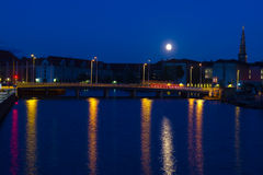 Supermoon over the canals of Copenhagen. Royalty Free Stock Photo