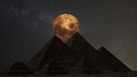Supermoon over the great pyramids, Cairo, Egypt. Timelapse. stock footage
