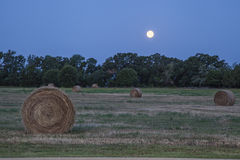 Supermoon over hay bales stock image