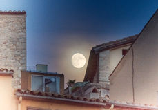 Supermoon over the rooftops of the old town of Girona, Catalonia Stock Photography