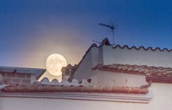 Supermoon over the rooftops of the old twon of Girona, Catalonia Royalty Free Stock Images