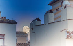Supermoon over the rooftops of the old twon of Girona, Catalonia Stock Photography
