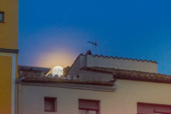 Supermoon over the rooftops of the old twon of Girona, Catalonia Stock Photos