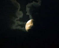 Supermoon Partly Hidden by Clouds Royalty Free Stock Photography