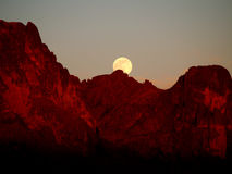 Supermoon Rising over the Superstition Mountains at Sunset Stock Image
