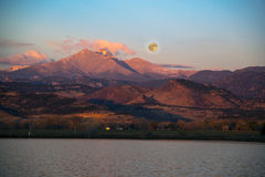 Supermoon setting over Longs Peak mountains Stock Photography