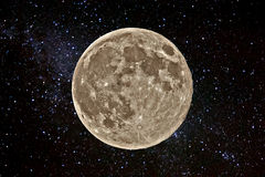 Supermoon against night sky full of stars (abstract) Royalty Free Stock Photo