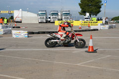 Supermotard amateur race. SALOU, SPAIN, NOVEMBER, 15, 2009: Unidentified pilot of motorcycling in the amateur championship of supermotard, a local exhibition in royalty free stock photos