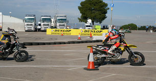 Supermotard amateur race. SALOU, SPAIN - SEPTEMBER, 15, 2009: Unidentified pilots of motorcycling in the amateur championship of supermotard, a local exhibition royalty free stock photos