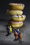 Supersize epidemic - people in line for donuts. Large fries and a soda Stock Photography