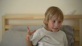 Superslowmotion shot of a little boy throwing napkins up celebrating his recovery from illness stock video