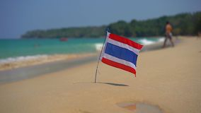 Superslowmotion shot of a national flag of Thailand on a beautiful beach. Tropical vacation concept. Travel to thailand. Concept stock video