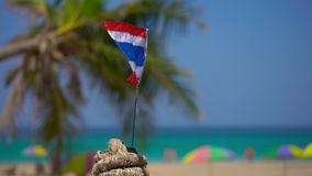 Superslowmotion shot of a national flag of Thailand on a beautiful beach. Tropical vacation concept. Travel to thailand. Concept stock video footage