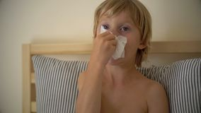 Superslowmotion shot of a sick little boy in a bed. Baby flu concept stock video footage