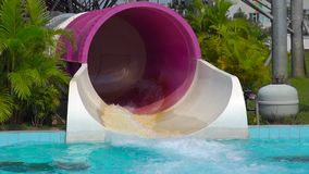 Superslowmotion shot of a water coming from a big tube in a water entertainment park.  stock footage