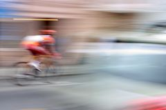 Supersonic Bicycle. A racing bike rider's fast speed is accentuated by the intentional slow shutter blur. The blur also removes all those troublesome adds from stock image