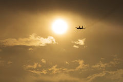 Supersonic jet fight airplane flying during sunset Stock Photos