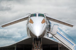 Supersonic jet plane. On the ground boarding with blue sky in background Stock Photo