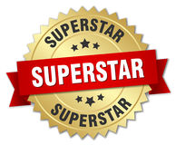 Superstar 3d gold badge. With red ribbon Stock Photo