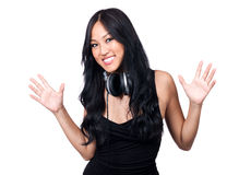 Superstar DJ. A young girl with her hands up and headphones around her neck Stock Image